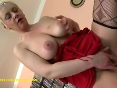 wicked housewife playing with her glass dildo