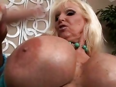 tanned blonde with massive boobs engulfing